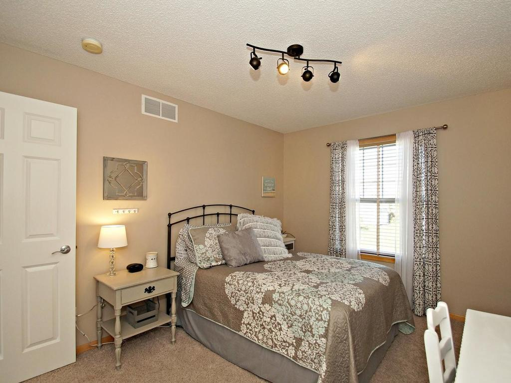 Large 3rd bedroom with closet organizer shown with a queen bed!