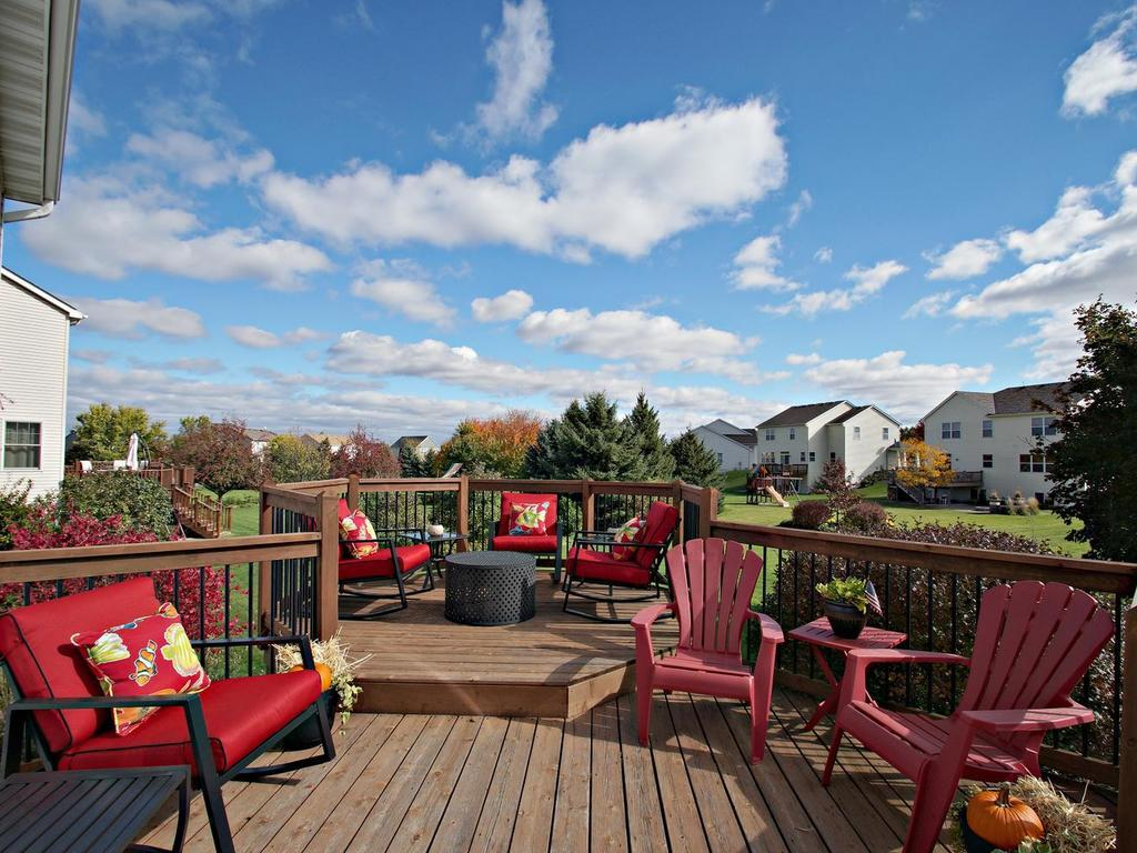 Large two tier deck overlooks the lush green grass, third acre lot more brilliant landscaping.
