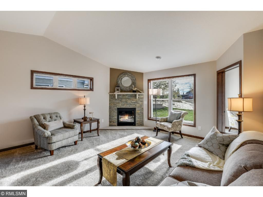 Sunfilled Living Room.Enjoy The Ambiance And Warmth Of This Ledgestone Gas  Fireplace.