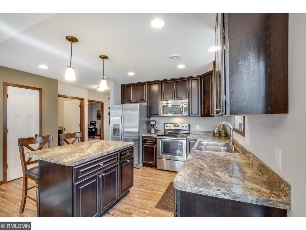 The kitchen has recessed lighting and luxury vinyl plank flooring from the front door through to the dining room for easy maintenance.
