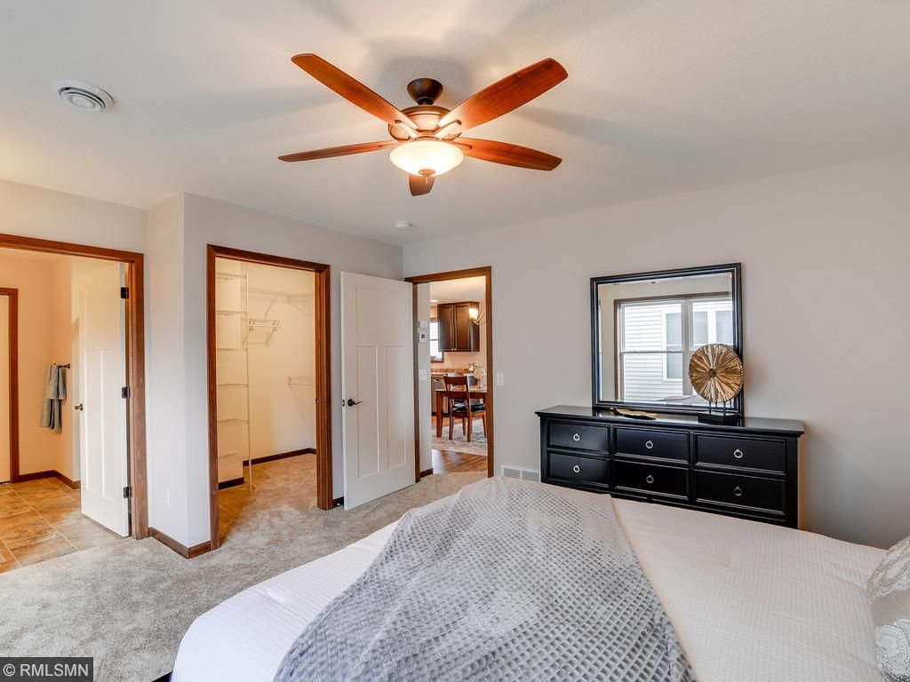 The master suite has a private 3/4 bath including a 4' shower with glass doors, 10' linen closet and large walk in closet with Superglide closet organizers.