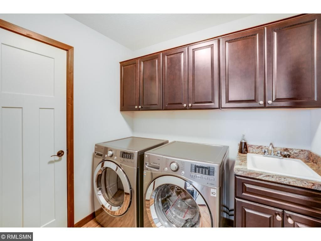 The laundry room offers an incredible amount of storage with wall to wall cabinets and storage closet and deep laundry tub. This home includes a beautiful Samsung front load washer and dryer.