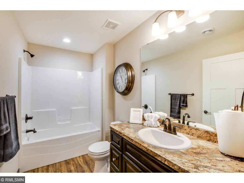 """This is the main/guest bath with shower tub combination.  We have added upgraded oil rubbed bronze fixtures, 35"""" high vanity and luxury vinyl plank flooring."""