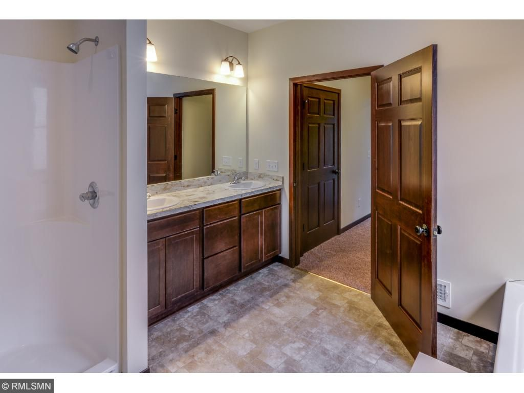 Master Bath Adjoins His and Her Closets for Your Wardrobe.