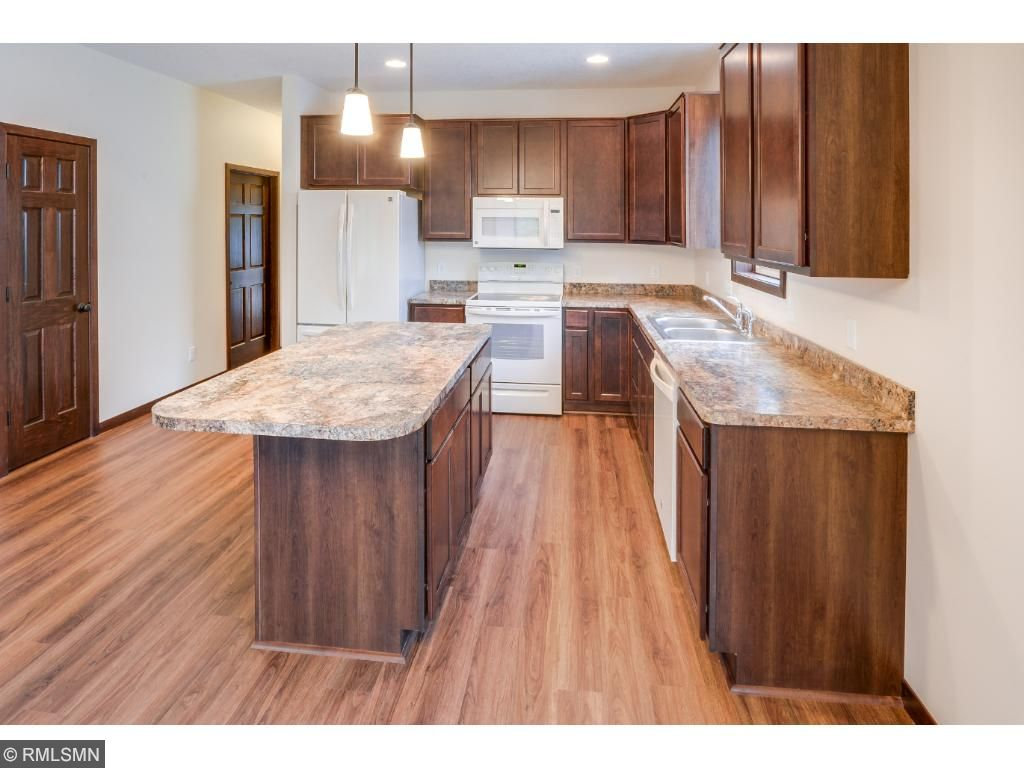 Delightful Kitchen has a Center Island Giving Plenty of Space to Prepare Your Gourmet Meals!