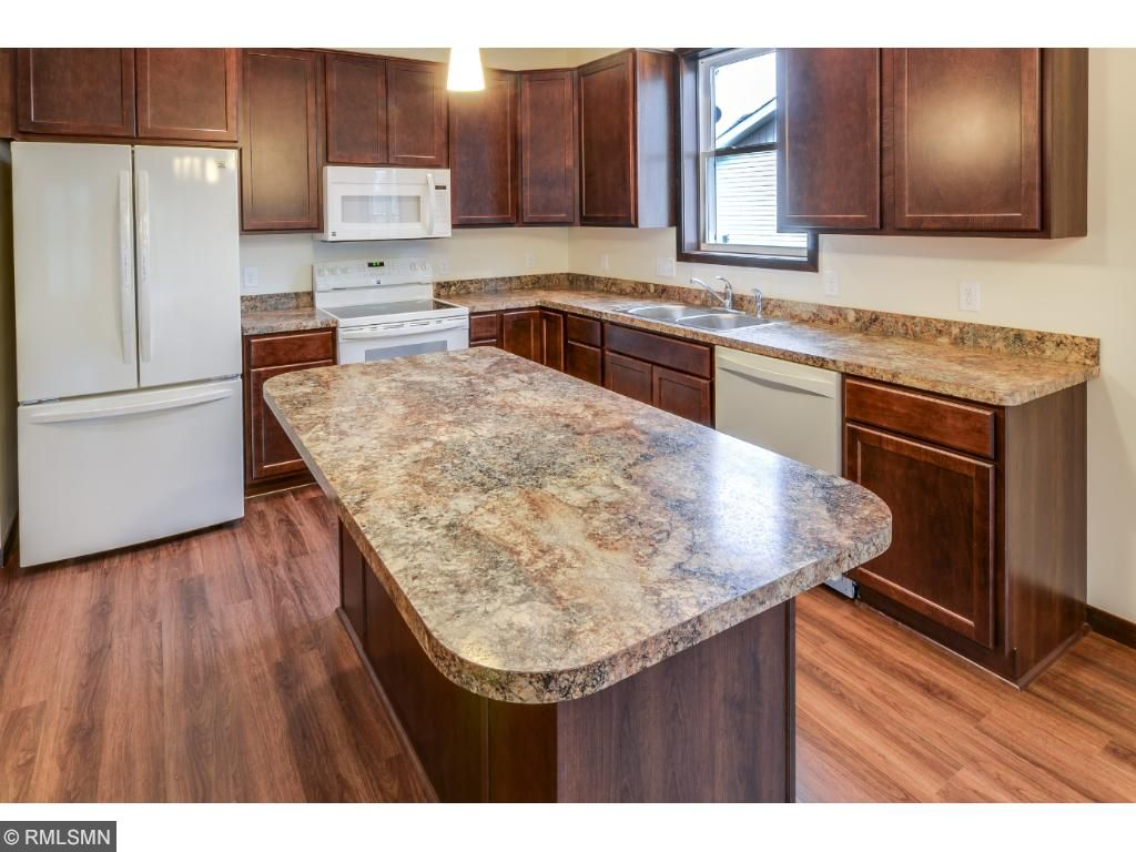 Kitchen Island Gives Additional Food Prep Spot and Storage.