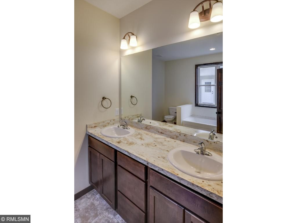 Master Bath has Double Sinks, Separate Shower and Tub Giving a Spa Like Private Retreat.