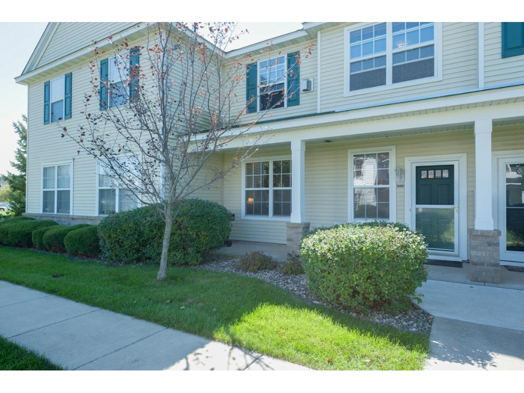 This wonderful townhouse features a front porch/patio facing the yard & trees.