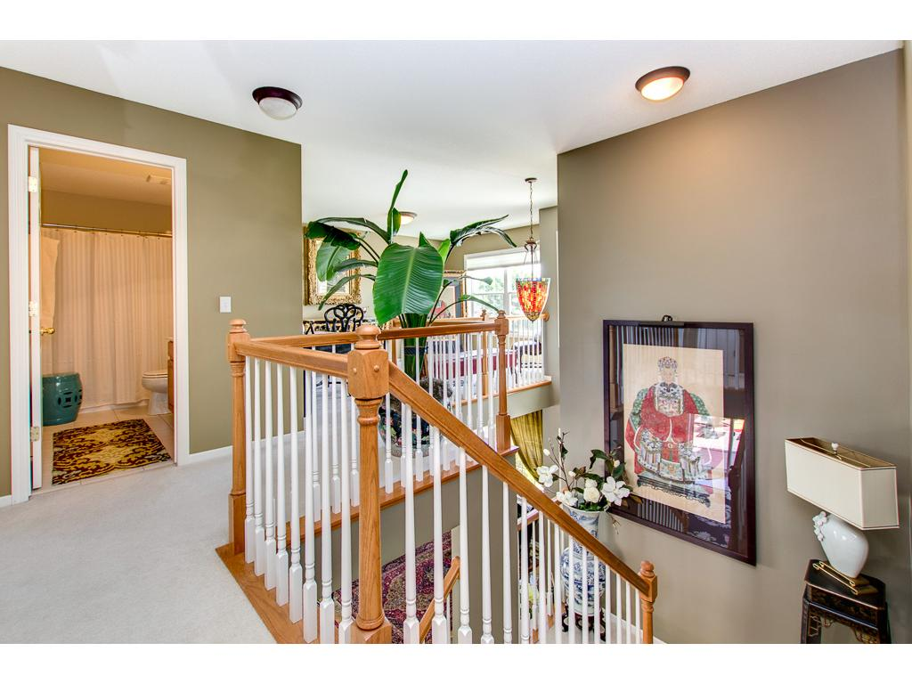 The upper level landing is spacious, open and leads to the upper level loft!