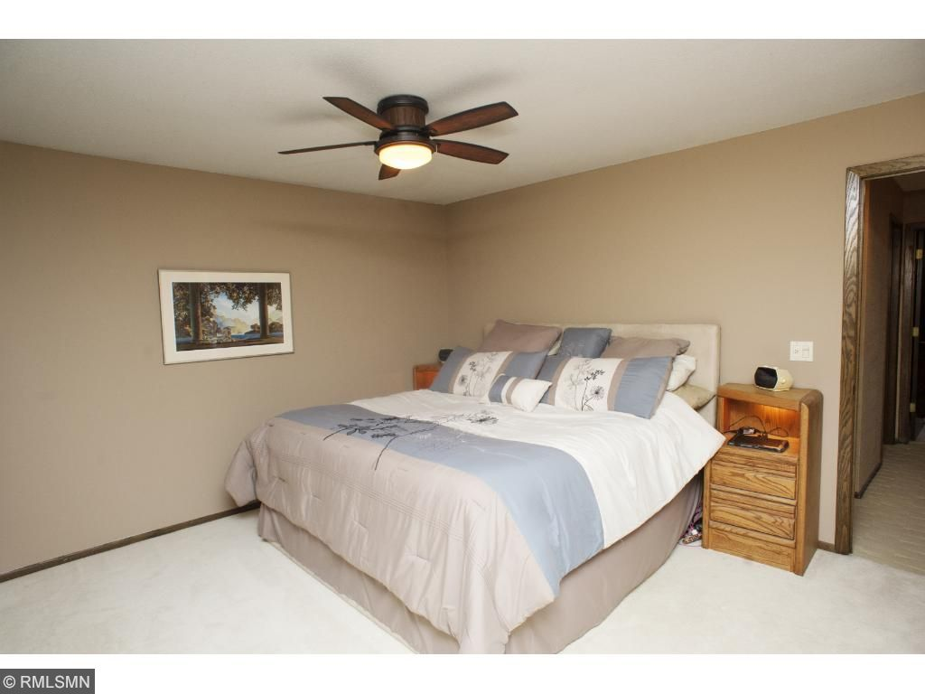 Upper level has three bedrooms. The largest is a master suite.