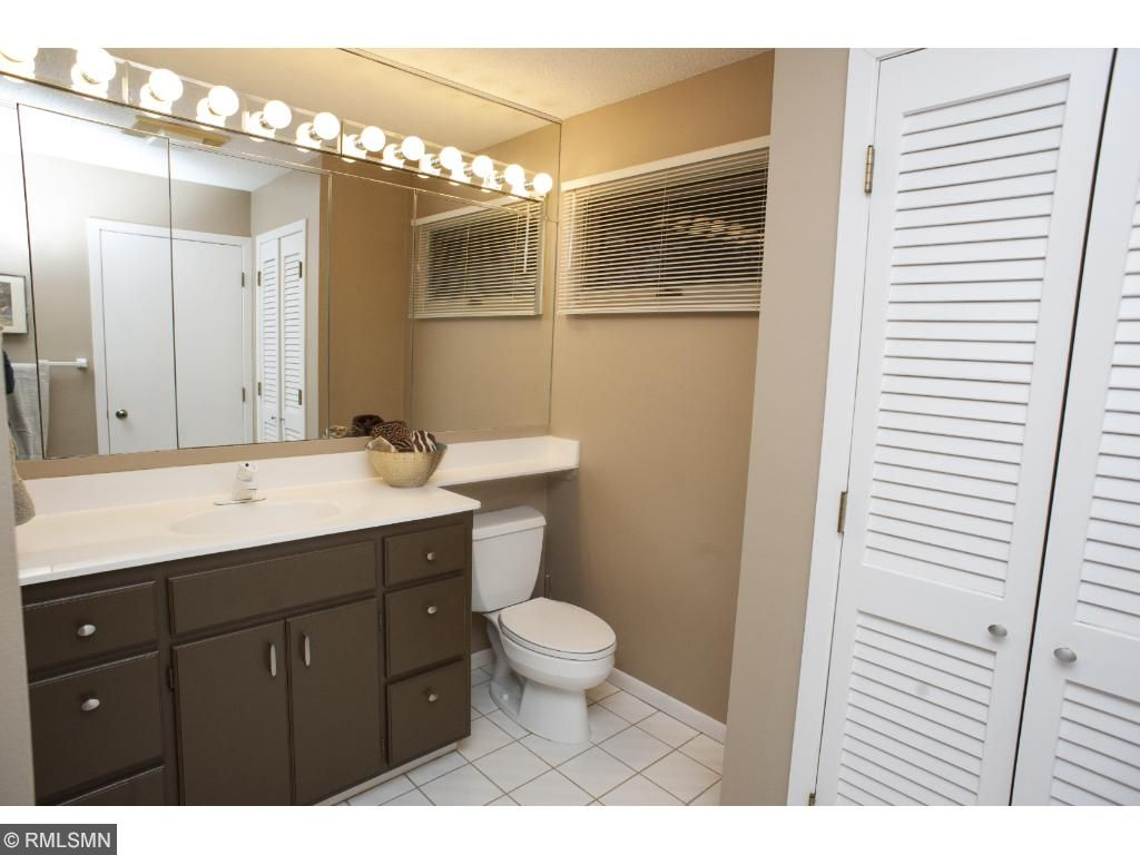 Master three quarter bath has a huge walk-in closet.