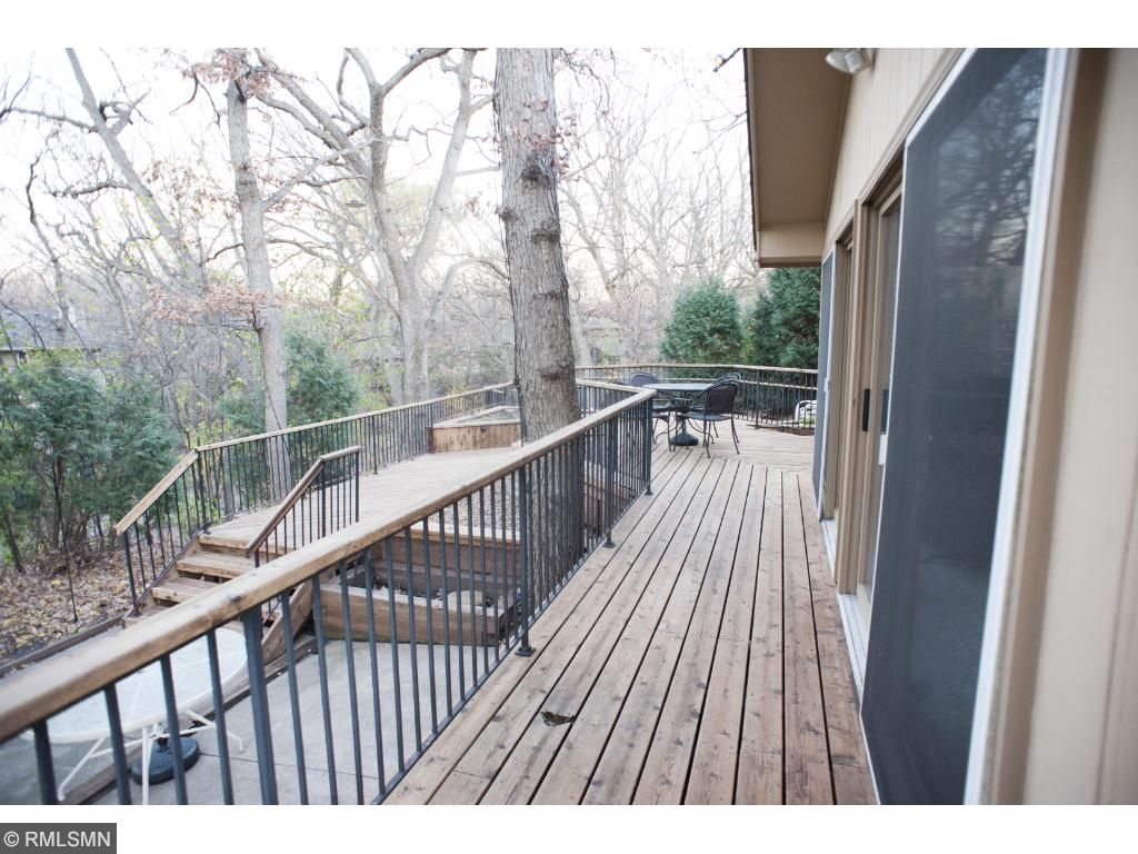 5ft deck goes around the three season porch ~ the porch is walled with sliding doors for access to all areas of the porch.