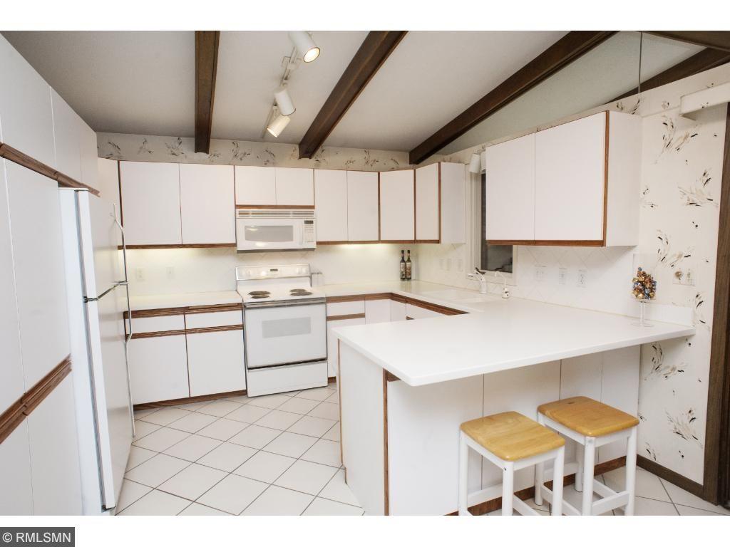 Terrific working kitchen tucked away from the walkways.