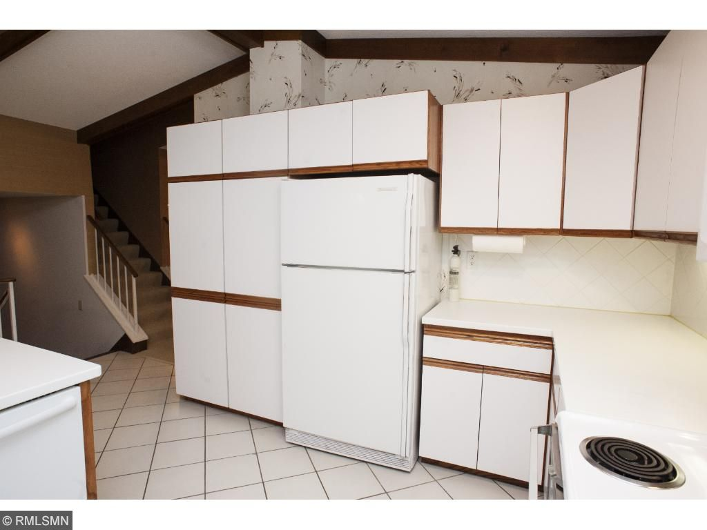 Kitchen has lots of cabinets and storage.