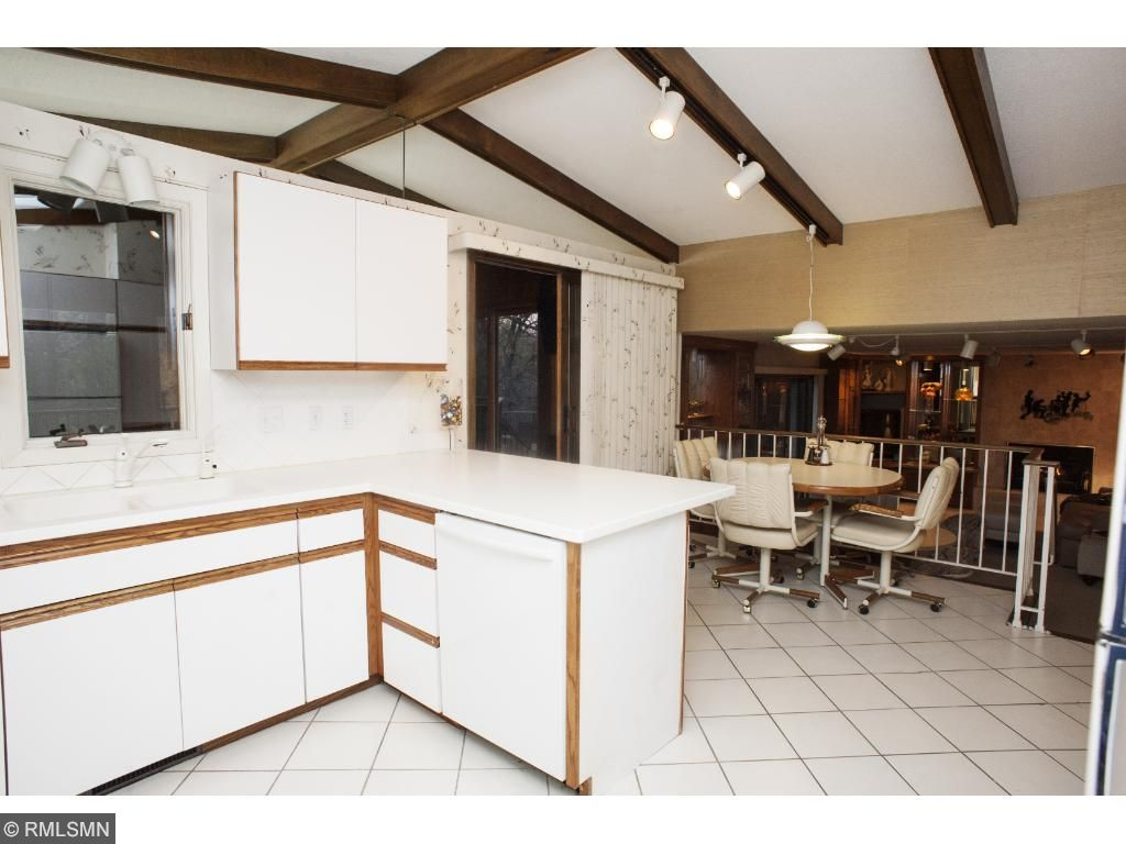 Kitchen overlooks the breakfast eating area and family room.