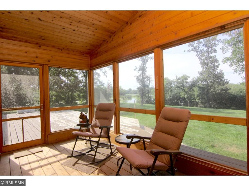 Ahhh.... to come home to this every day! A large deck to enjoy by day and the screen porch for bug free enjoyment by night. Not to mention the terrific back yard.