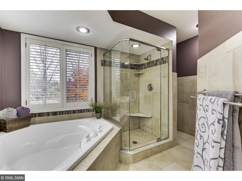 Retreat to the master bath with walk-in shower and spa tub.