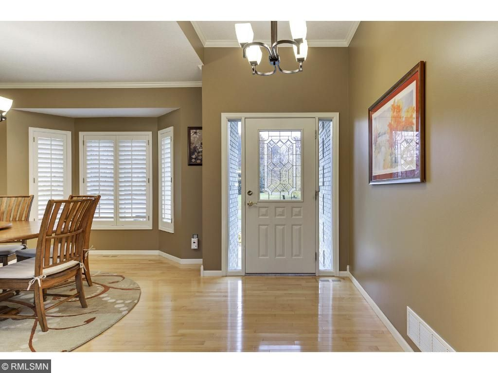 Welcoming entry and large bay window.