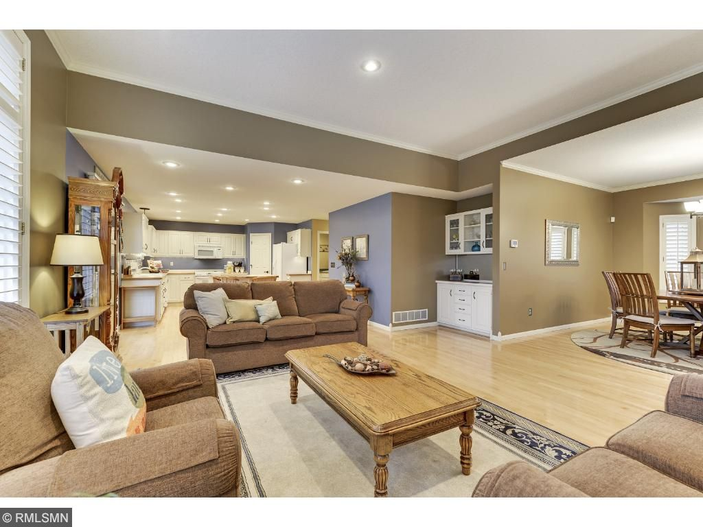 Open floor plan and stunning hardwood floors.  Notice the plantation shutters.