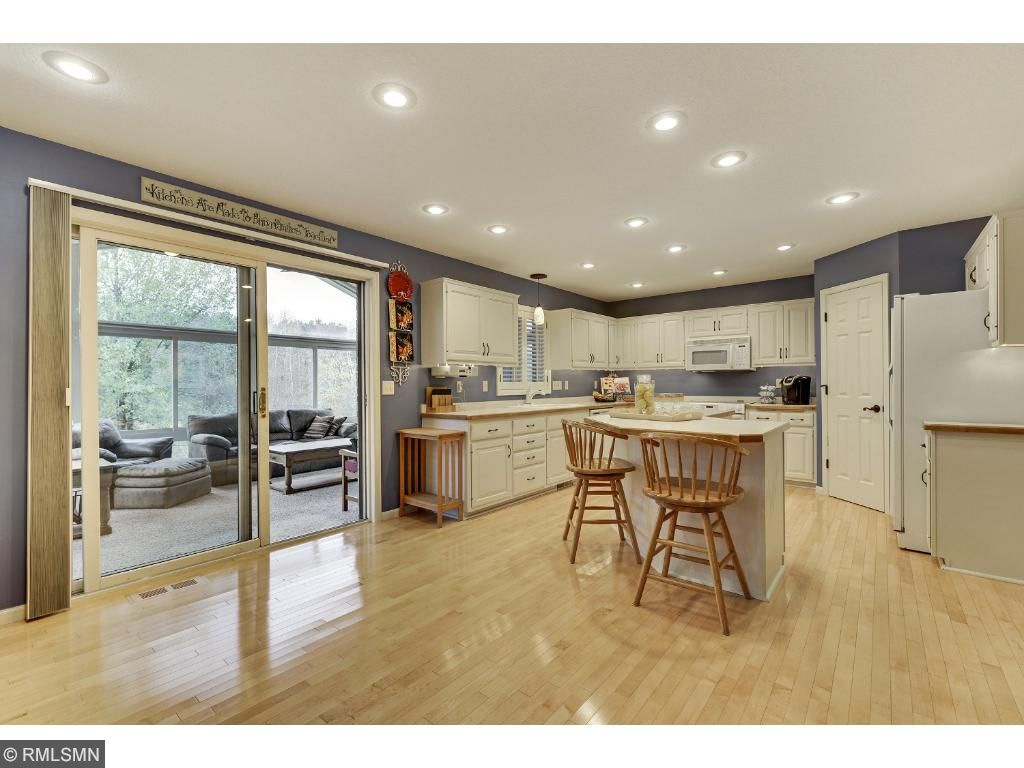 Kitchen has walk-in pantry and center island is great for entertaining.