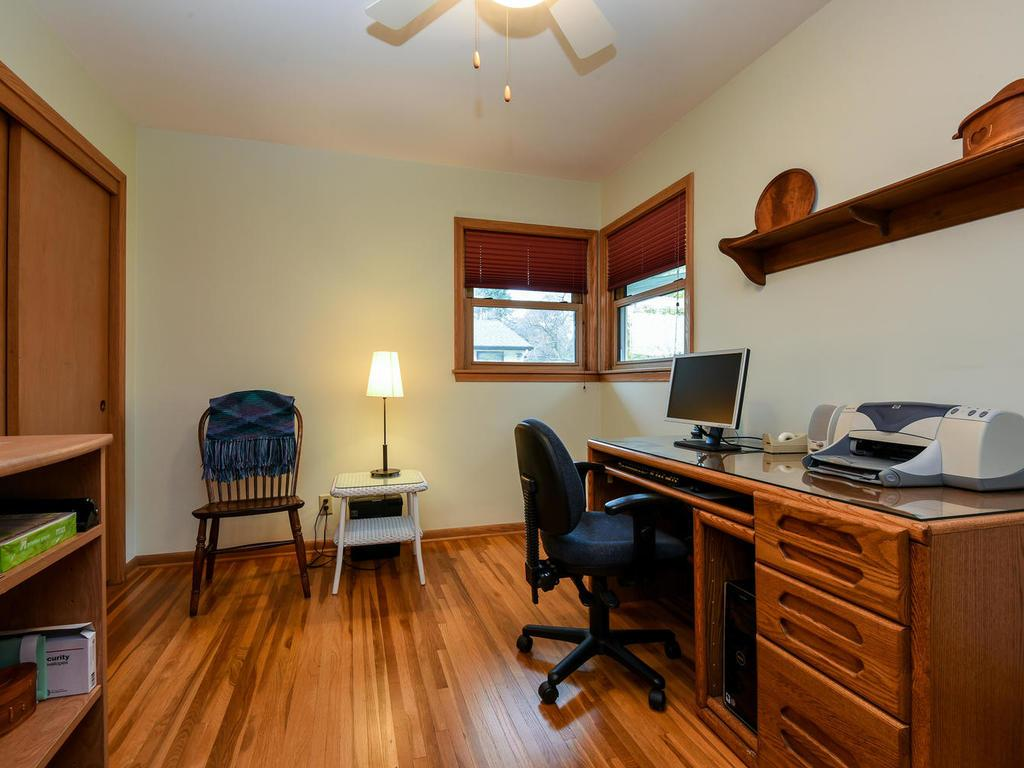 Main level bedroom number three currently used as an office.