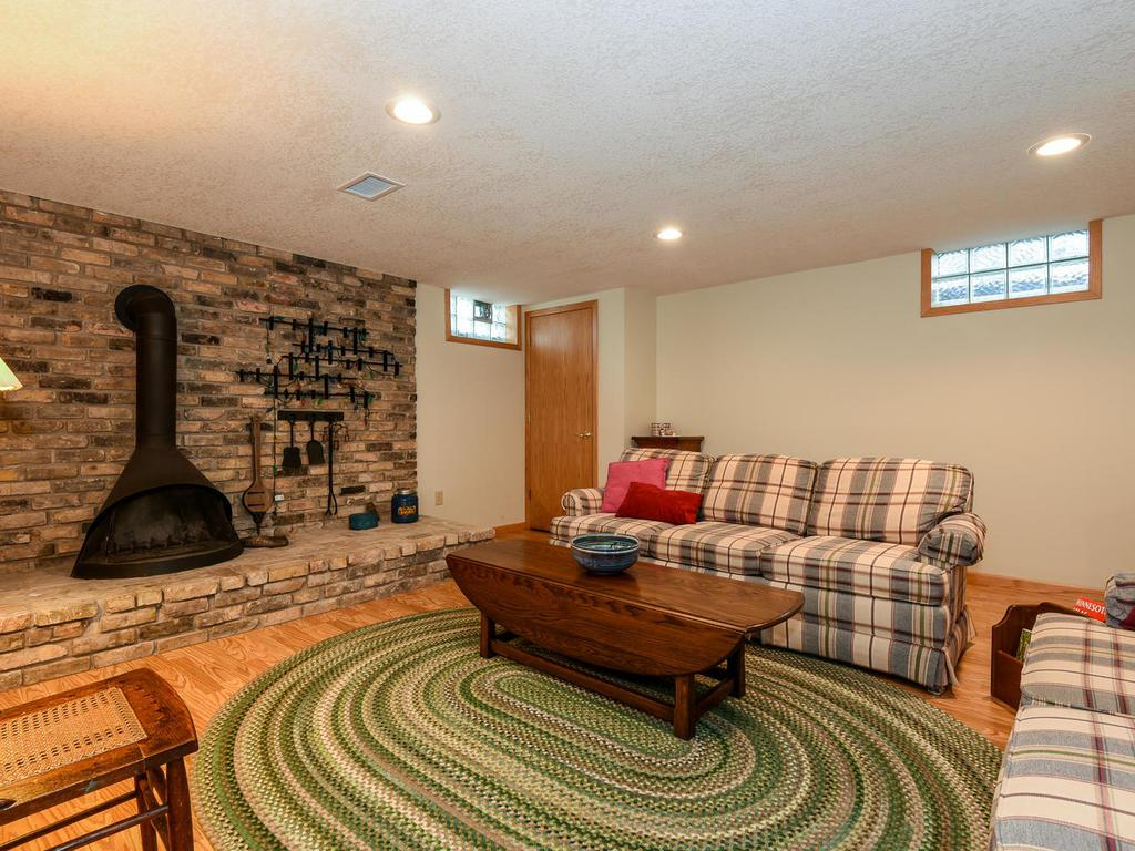 Very comfortable family room with recessed lighting, newer carpet and wood burning stove.