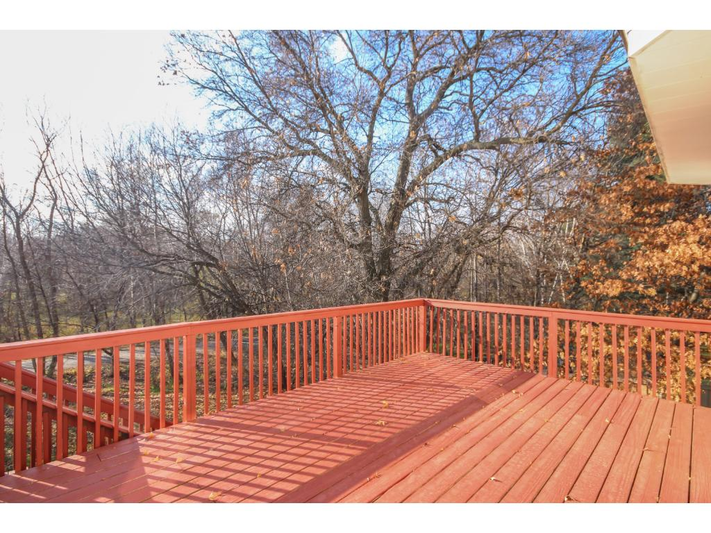 Large deck overlooking spectacular private yard.