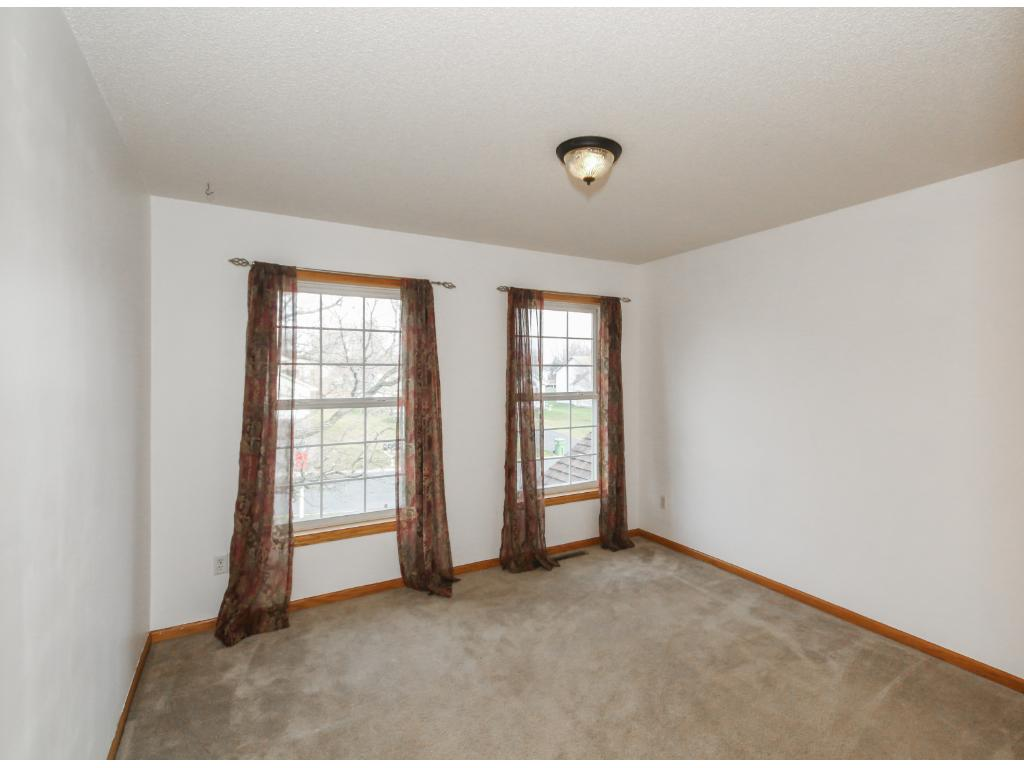 Private owner's suite with stately windows and room for king bed and lots of furniture.