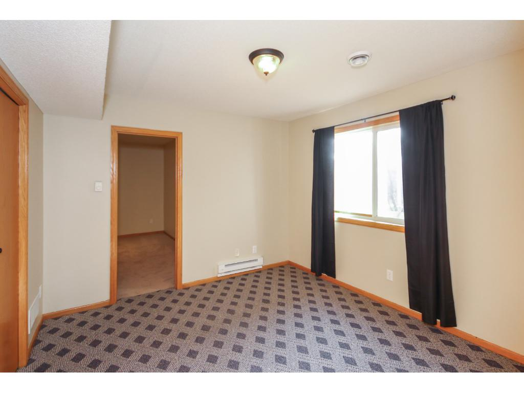 Lower level fourth bedroom with private office, hobby room.  Great for guests and teens!