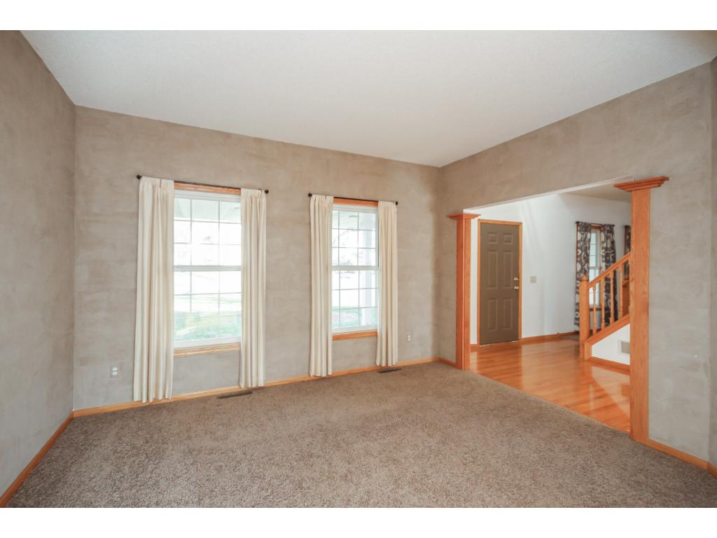 Comfortable office off two-story foyer.
