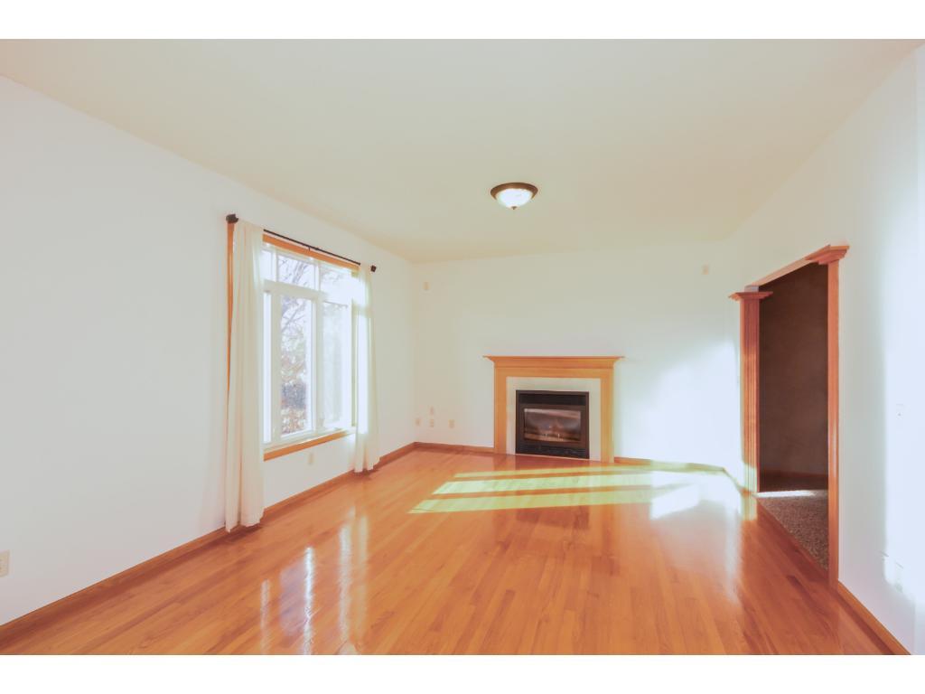 Gleaming hardwood floors in family room.