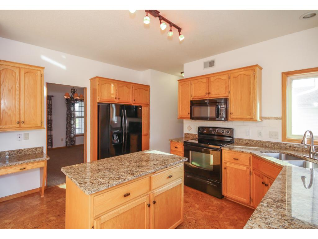 Gourmet kitchen space with granite counters and updated appliances