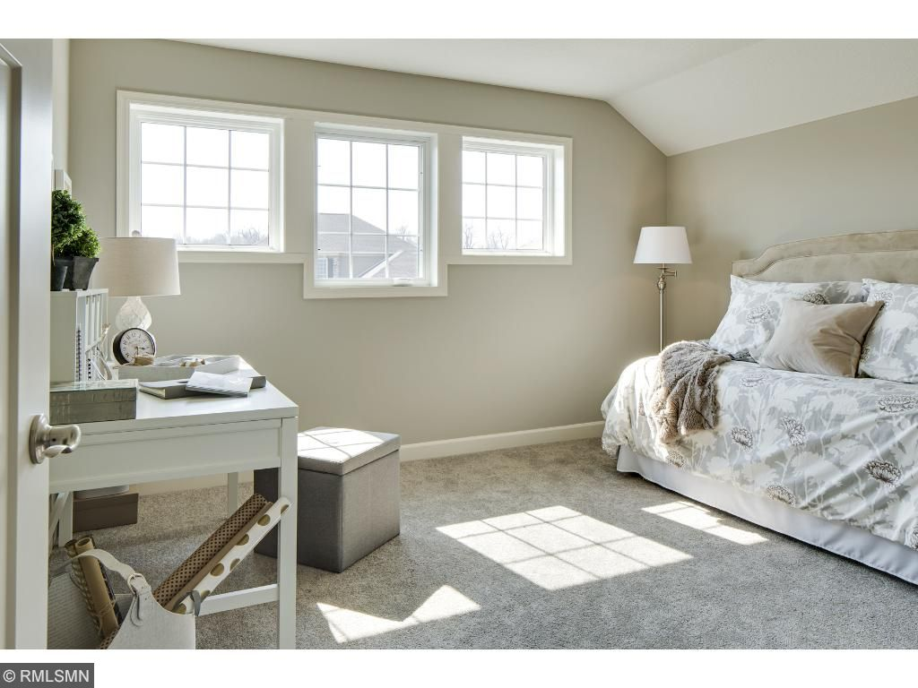 Bedroom 2; for illustrative purposes only. Photos are from our model home.