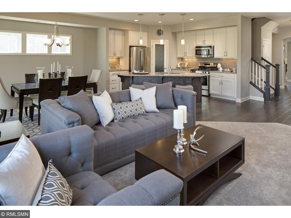 Family Room/Kitchen/Dining; for illustrative purposes only. Photos are from our model home.