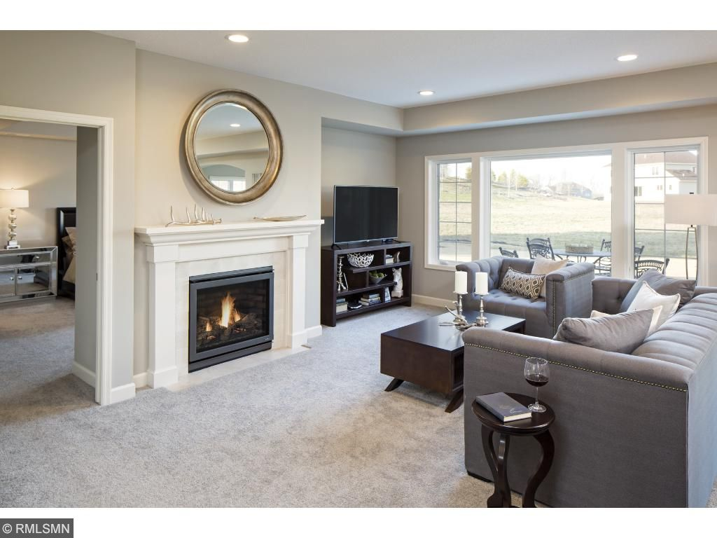 Family Room/Fireplace; for illustrative purposes only. Photos are from our model home.