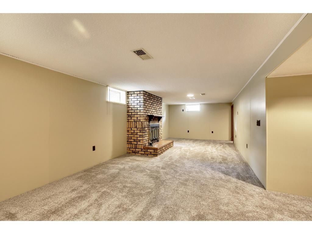 Huge lower level family room with wood burning fireplace