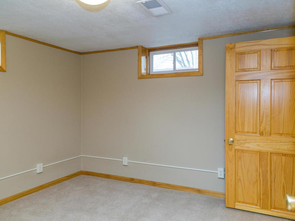 Lower level room can be used as office / den or non-conforming 3rd bedroom.  Features it's own private bathroom and extra large, well-lit closet.