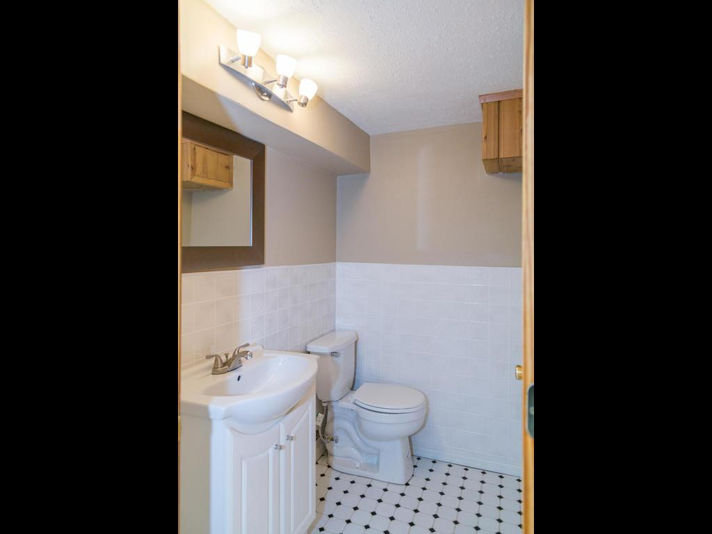 Private bathroom in lower level has new fixtures and ceramic tile floors.