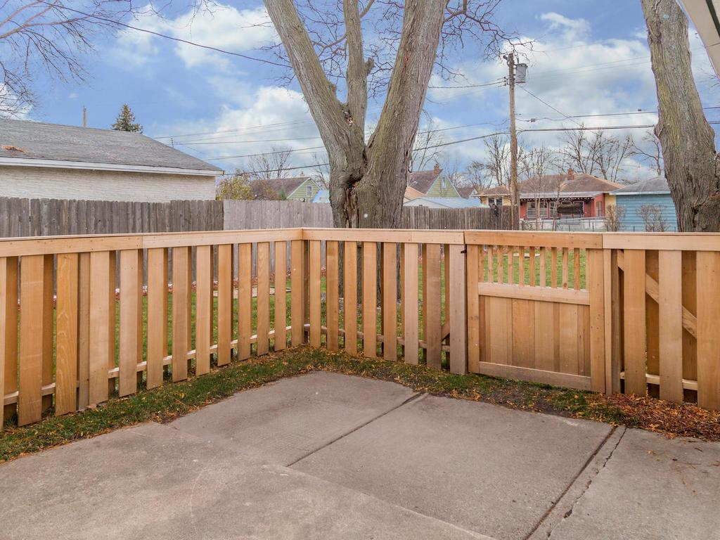 Patio space just behind the home is the perfect location for a grill and outdoor table and chairs.  Backyard is fully fenced.