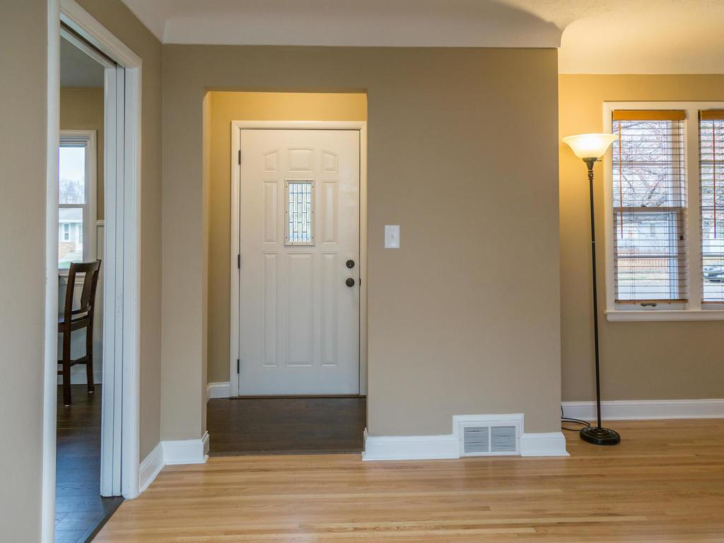 Foyer features new flooring, new door, and spacious, convenient closet.