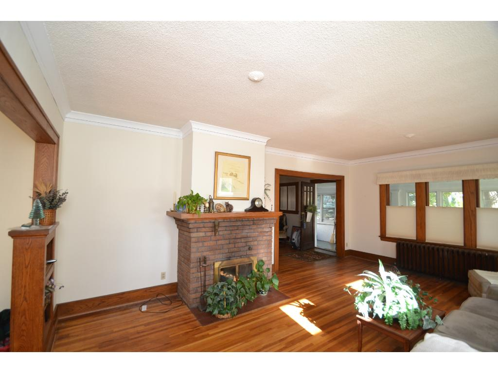 Brick woodburning fireplace in Living Room