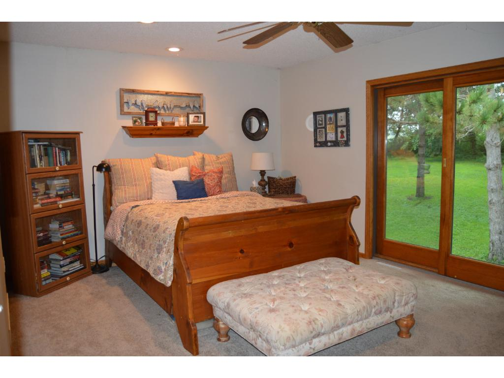 Main floor master has a sliding door to the backyard, walk in closet and a spacious master bath with separate whirlpool tub and shower.