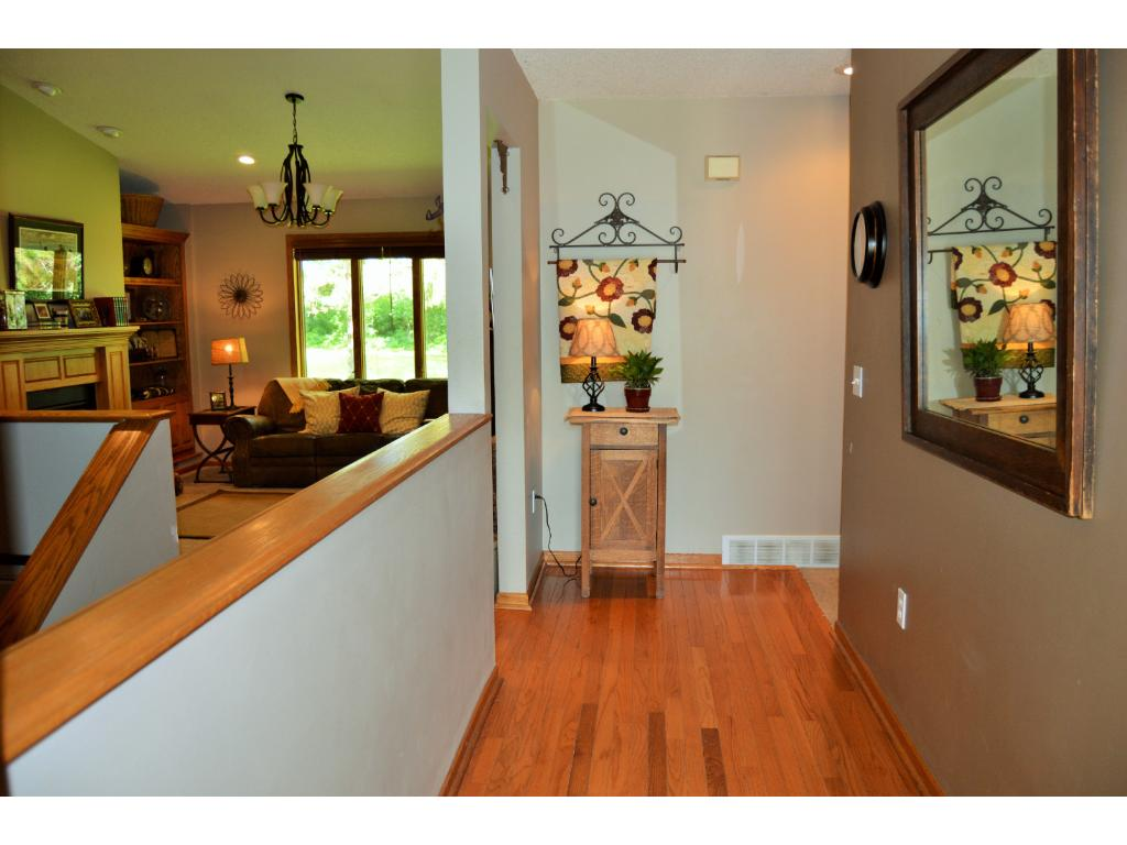 Open and bright entry way with gorgeous hardwood floors.