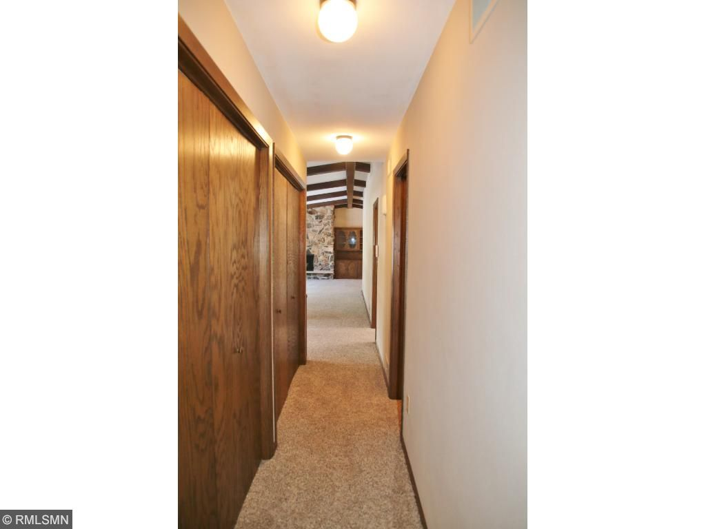 Hallway to bedrooms have closets for added storage on the main level.