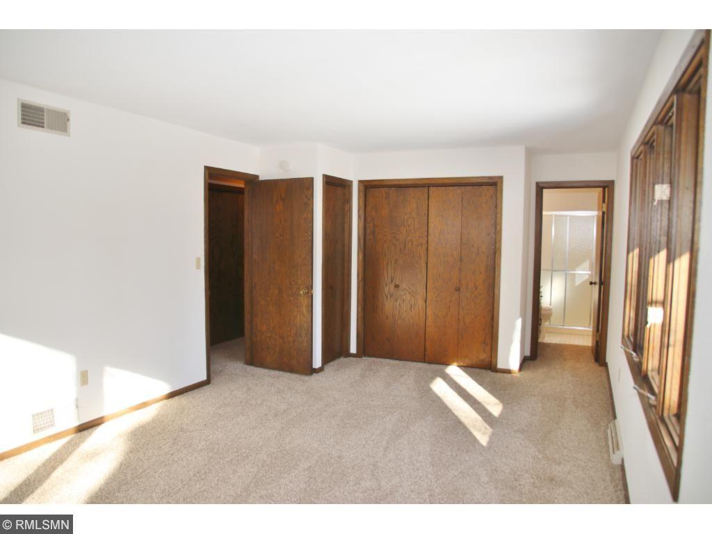 View of master bedroom toward closets and 3/4 bath.