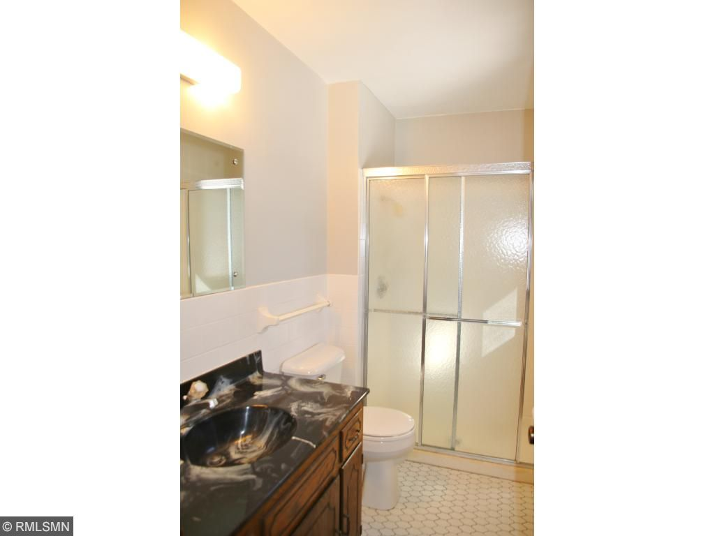 Master 3/4 bath has new toilet and updated shower stall.