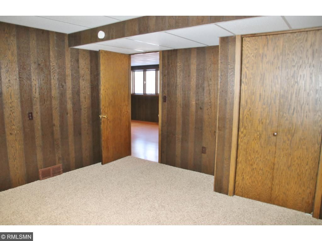 Bedroom 4 in the lower level.  Bedroom 5 is similar and located next to this one.  Both have closets and windows.