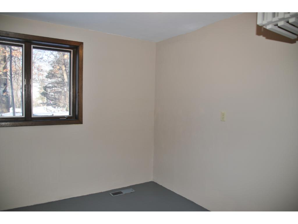 Large storage or work room to the right of garage entrance.  Floor has a fresh coat of paint and laundry shoot is also located in this room.