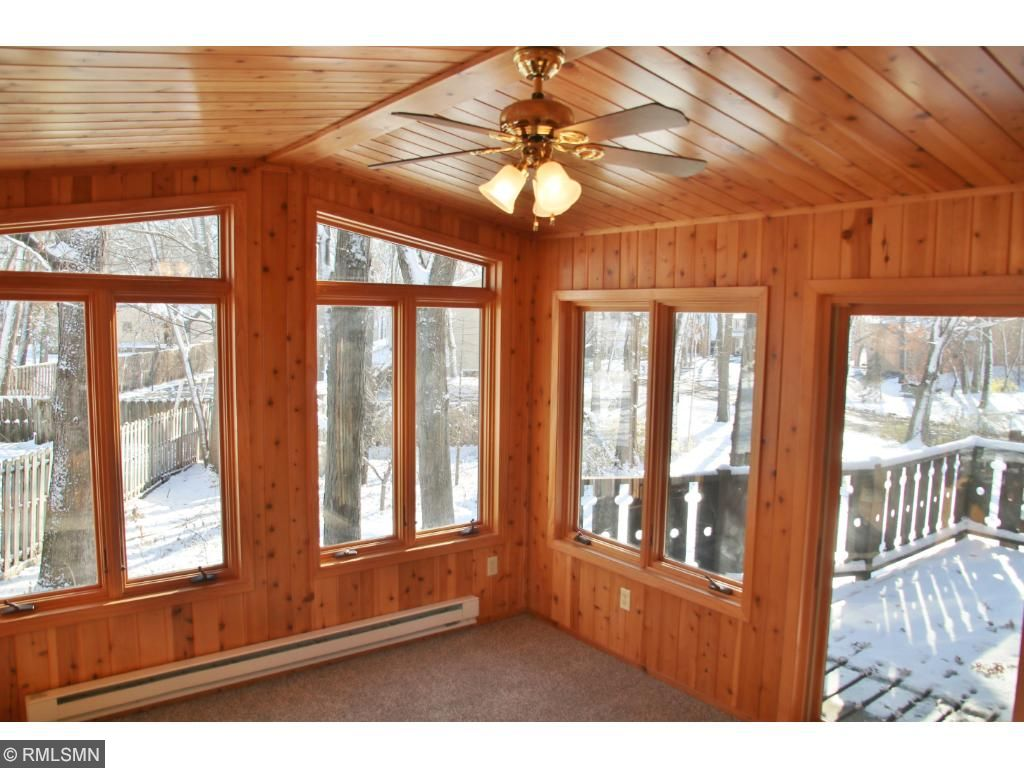 Pine tongue and groove woodwork surrounds this spacious 4 season porch.