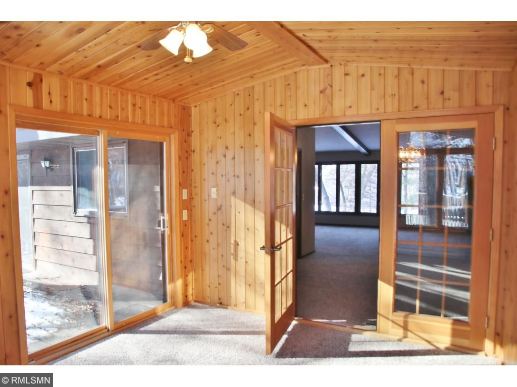 Doors lead to deck and your wooded backyard.